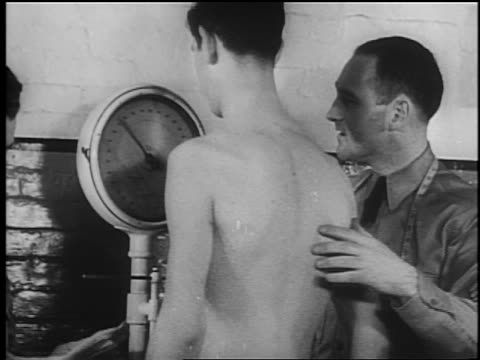 b/w 1941 shirtless military recruit being weighed on scale / documentary - military recruit stock videos & royalty-free footage