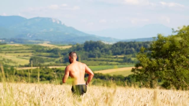 shirtless young adult man running through fields - semi dress stock videos & royalty-free footage