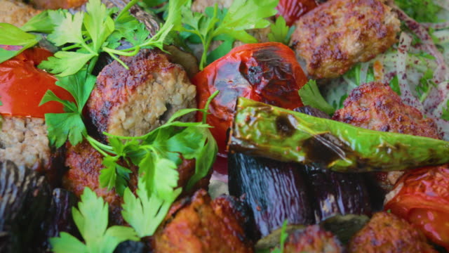shish kebab with parsley, pepper, aubergine and tomato as turkish cuisine - skewer stock videos & royalty-free footage