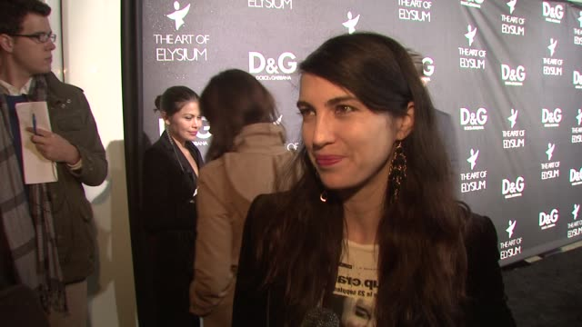 shiva rose on why she loves dolce & gabbana, on what she's wearing, on the art of elysium, on what she wants for christmas, and on her plans for new... - dolce & gabbana点の映像素材/bロール