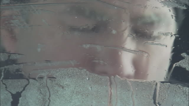 a shivering cold blizzard survivor sits in his vehicle stuck in the snow. - shaking stock videos & royalty-free footage