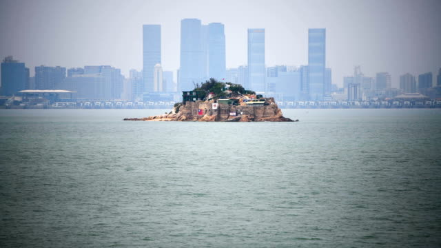 Shiyu or Lion Islet part of Kinmen County one of Taiwan's offshore islands is viewed through the hole of a gun emplacement in front of the Chinese...