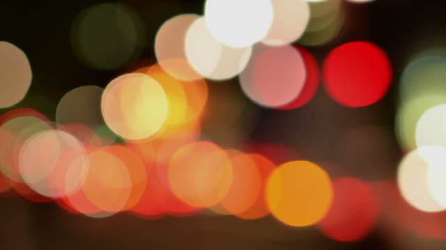 cu t/l sho tof abstract defocus lights night time vehicle city and traffic lights passing through frame back side lights static / london, greater london, united kingdom - back lit bildbanksvideor och videomaterial från bakom kulisserna