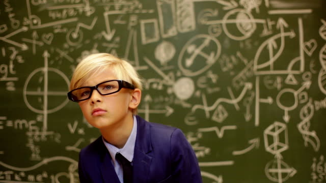 shock teenage boy behind a blackboard with telescope - genius stock videos & royalty-free footage