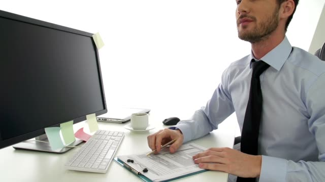 Shocked businessman looking at document