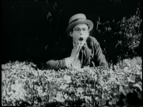 b/w 1918 shocked man in straw hat peering from behind hedge / short - 1918 stock videos and b-roll footage