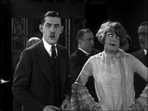 b/w 1926 shocked man (charley chase) standing by annoyed flapper / feature - 1926 stock videos & royalty-free footage