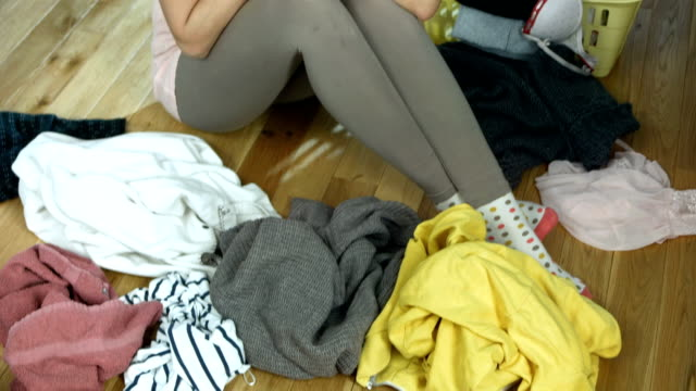 HD: Shocked Woman Doing Laundry