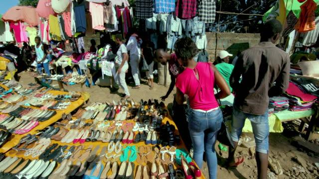 shoe & clothing stall at ngong road street market nairobi  kenya  africa - nairobi stock videos and b-roll footage