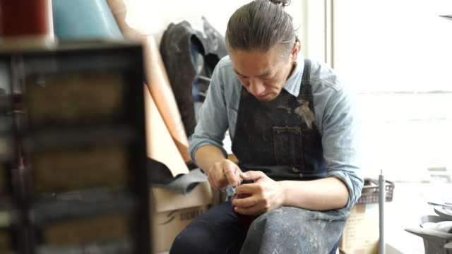 shoe designers working at the factory - craftsman stock videos and b-roll footage