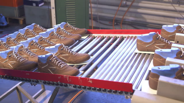 shoe production, woman put the  leather upper in a  machine with heat, close - leather shoe stock videos and b-roll footage