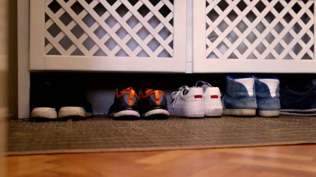 shoe rack with family storage space for shoes in domestic home - rack stock videos & royalty-free footage
