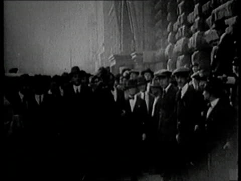 vidéos et rushes de shoeless joe jackson walking through a crowd of people / united states - 1910 1919