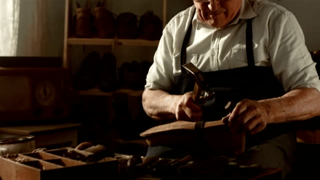 hd dolly: shoemaker fastening the outsole - craftsman stock videos and b-roll footage