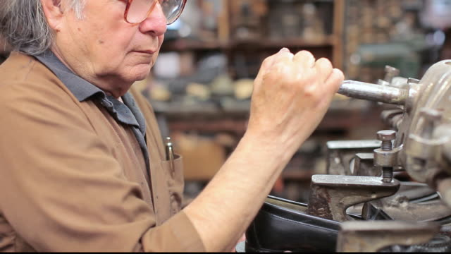 ms shoemaker repairing a shoe in his shop / santa monica, california, united states - letterbox format stock videos and b-roll footage