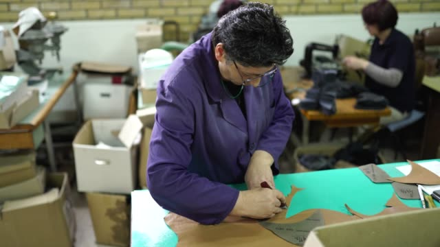 shoemaker working on a new shoe template - leather stock videos and b-roll footage