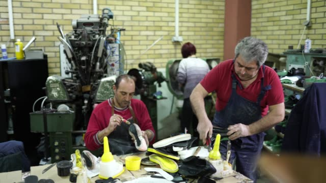 Shoemakers working on a new shoes
