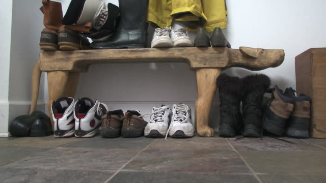 cu shoes in cloakroom, scarborough, new york, usa - hanging stock videos & royalty-free footage