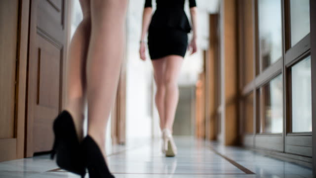 shoes of women walking in office - human foot stock videos and b-roll footage