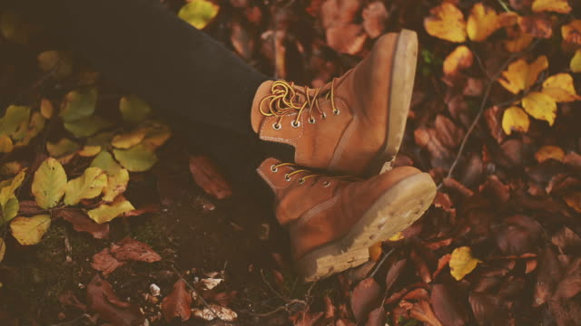 shoes on dry leaves - legs crossed at ankle stock videos & royalty-free footage