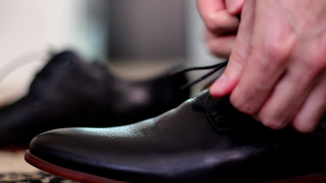 shoes - tie stock videos & royalty-free footage