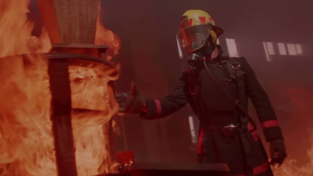 MS TS Sholt of Fireman pulling down burning piece of furniture