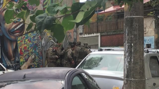 Shoot out between police and drug traffickers in a favela with residents caught in the middle
