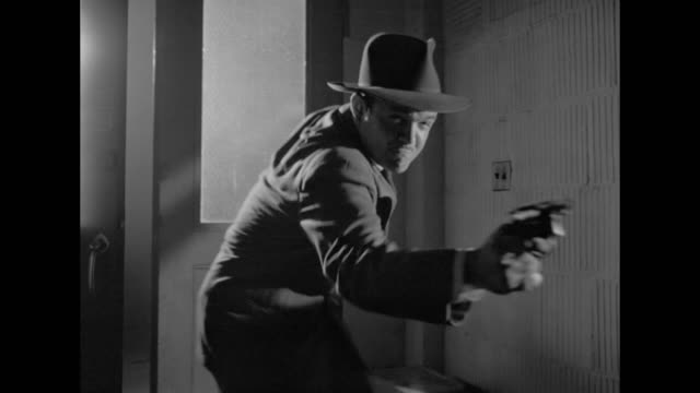 1948 shoot out in dark hallway results in wounded men - film noir style stock videos and b-roll footage