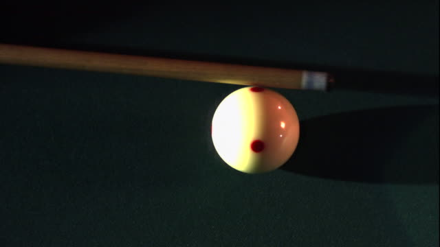 a shooter taps the cue ball during a game of billiards. - cue ball stock videos & royalty-free footage