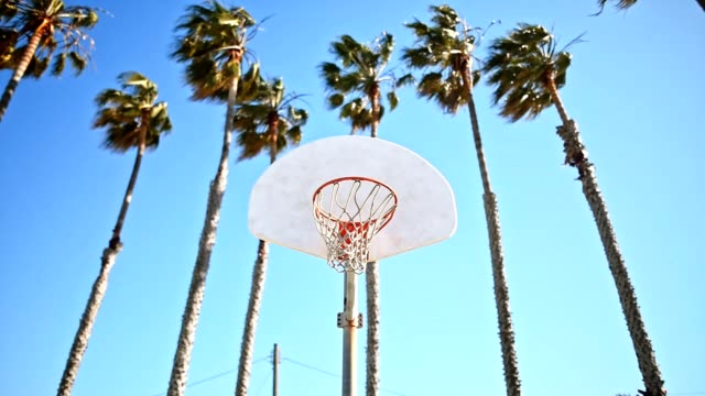 shooting a basketball in los angeles - net sports equipment stock videos & royalty-free footage