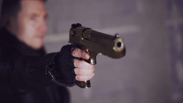 shooting a glock. mysterious man training shooting skills - leather jacket stock videos & royalty-free footage