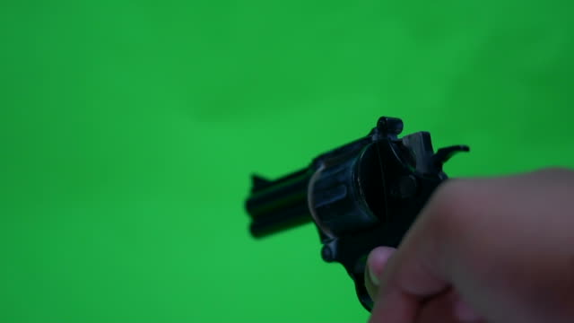 shooting a handgun,real time,isolated,studio lighting - gun stock videos and b-roll footage
