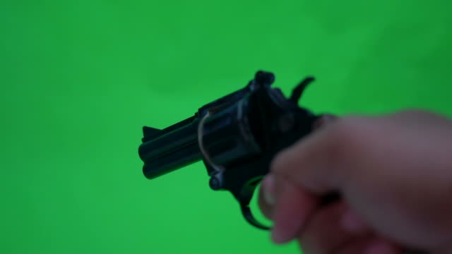 Shooting a handgun,real time,isolated,studio lighting