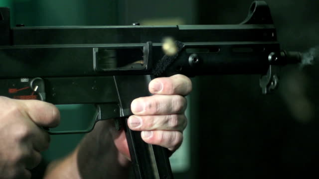 shooting a machine gun super slow motion - gun stock videos & royalty-free footage