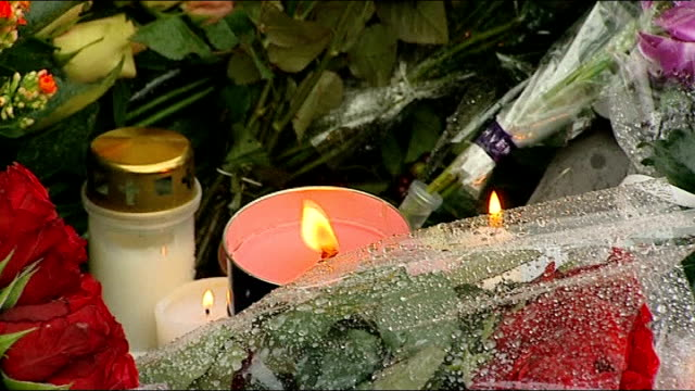 stockvideo's en b-roll-footage met memorial services held / more details of gunman emerge norway oslo ext candle in tin placed amongst tributes left for those killed by bomber and... - anders behring breivik
