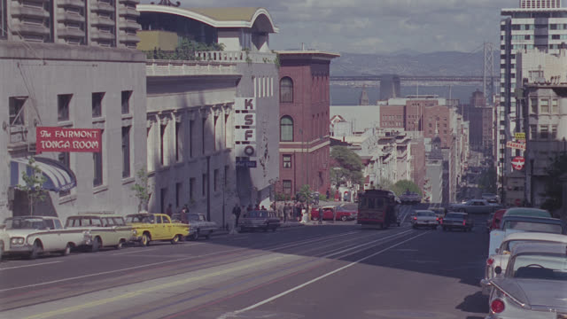 shooting down nob hill, california street, san francisco, to cable car coming up hill - nob hill stock videos & royalty-free footage