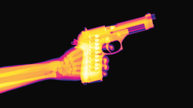stockvideo's en b-roll-footage met shooting gun colored x-ray - pistool handwapen