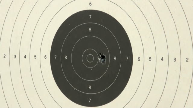 shooting handgun pistol at target range. - handgun stock videos and b-roll footage