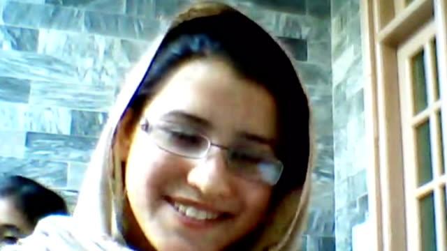 shooting of schoolgirl malala yousafzai / day of action planned pakistan kainat riaz interview via skype sot misses malala - 女子生徒点の映像素材/bロール