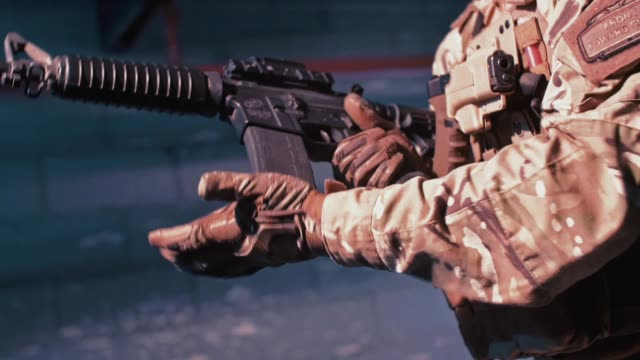 shooting preparations. loading gun - sniper stock videos & royalty-free footage