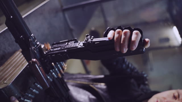 shooting preparations. man holding mp5 gun - macho stock videos & royalty-free footage