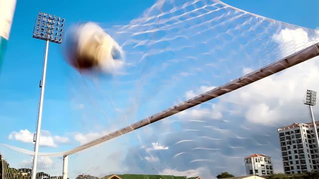 shooting soccer football to goal