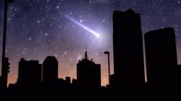 Shooting star above city