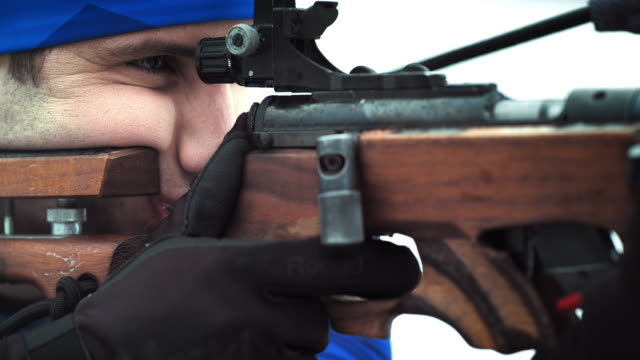 shooting the biathlon rifle at the competition - biathlon stock videos and b-roll footage