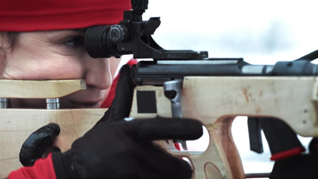shooting the rifle at the biathlon competition - biathlon stock videos and b-roll footage