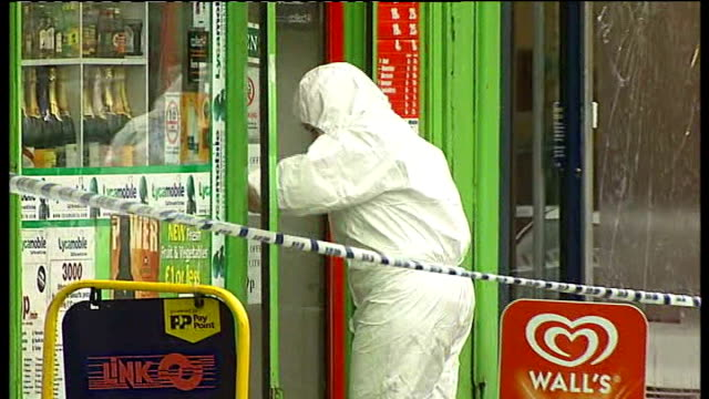 shooting trial of 5yearold victim thusha kamaleswaran march 2011 bvs forensic officer outside shop where shooting incident occurred forensic officers... - ストックウェル点の映像素材/bロール