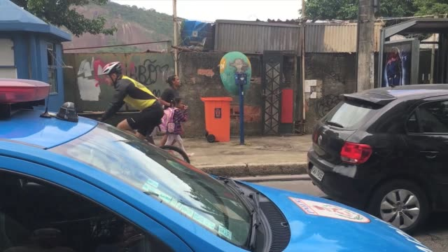 Shootout between police and drug traffickers in a favela with residents caught in the middle