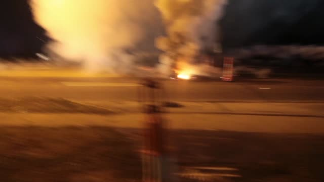 a shootout occurs after riot police fire tear gas and flashbangs at protesters in ferguson mo footage includes visual of police shooting rubber... - ミズーリ州点の映像素材/bロール