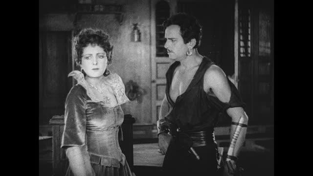 Shootout occurs when pirate (Douglas Fairbanks) saves woman