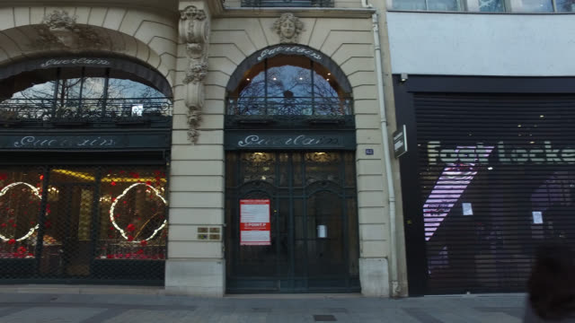 shop and restaurant closed on avenue des champs elysée, a day after french prime minister edouard philippe announced that france will shut shops,... - avenue des champs elysees stock videos & royalty-free footage